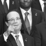 French President Hollande and attendees pose for a family photo during the Elysee Summit for Peace and Security in Africa in Paris